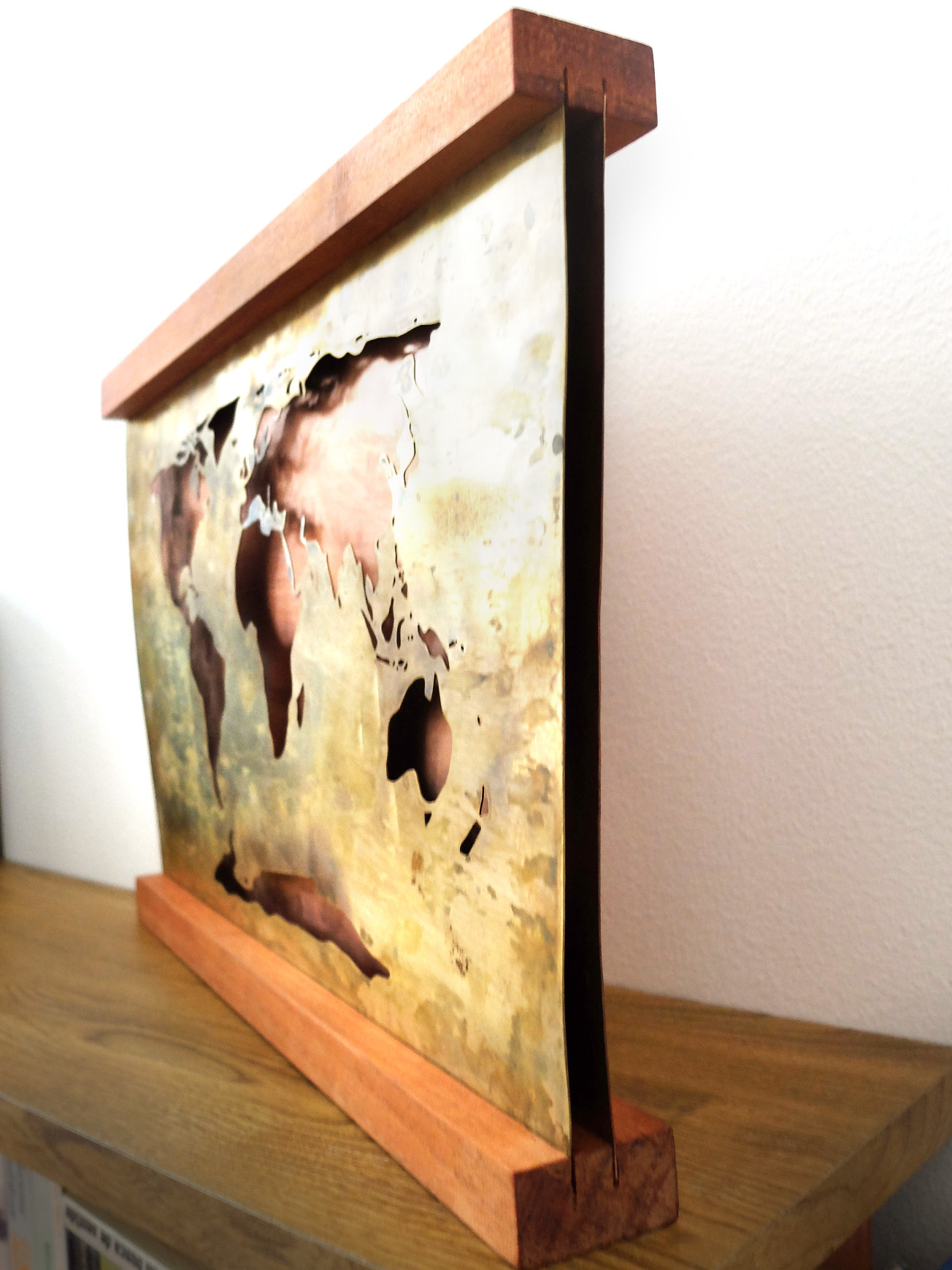 World map sa maria hermansson glass and metal art handmade world map in two layers of metal front sheet of brass with the continents sawed out by hand and a copper sheet behind it held steady in a frame gumiabroncs Image collections